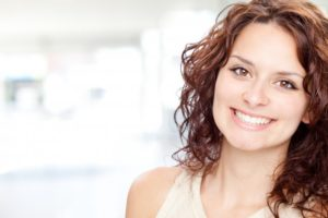 happy woman smiling with perfect teeth