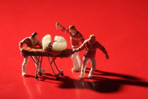 toy paramedics rushing to save tooth