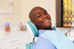 man smiling in dentist chair