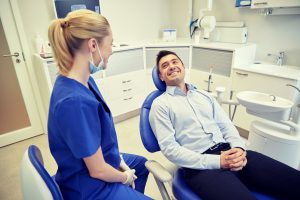 man and dental assistant in the office
