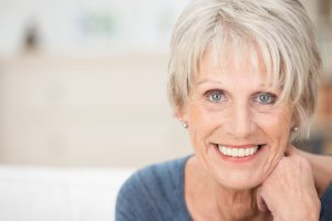Older woman with healthy smile at dentist.