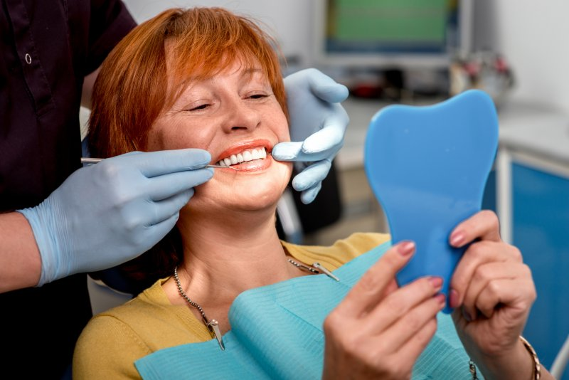 woman smiling after dental implant surgery